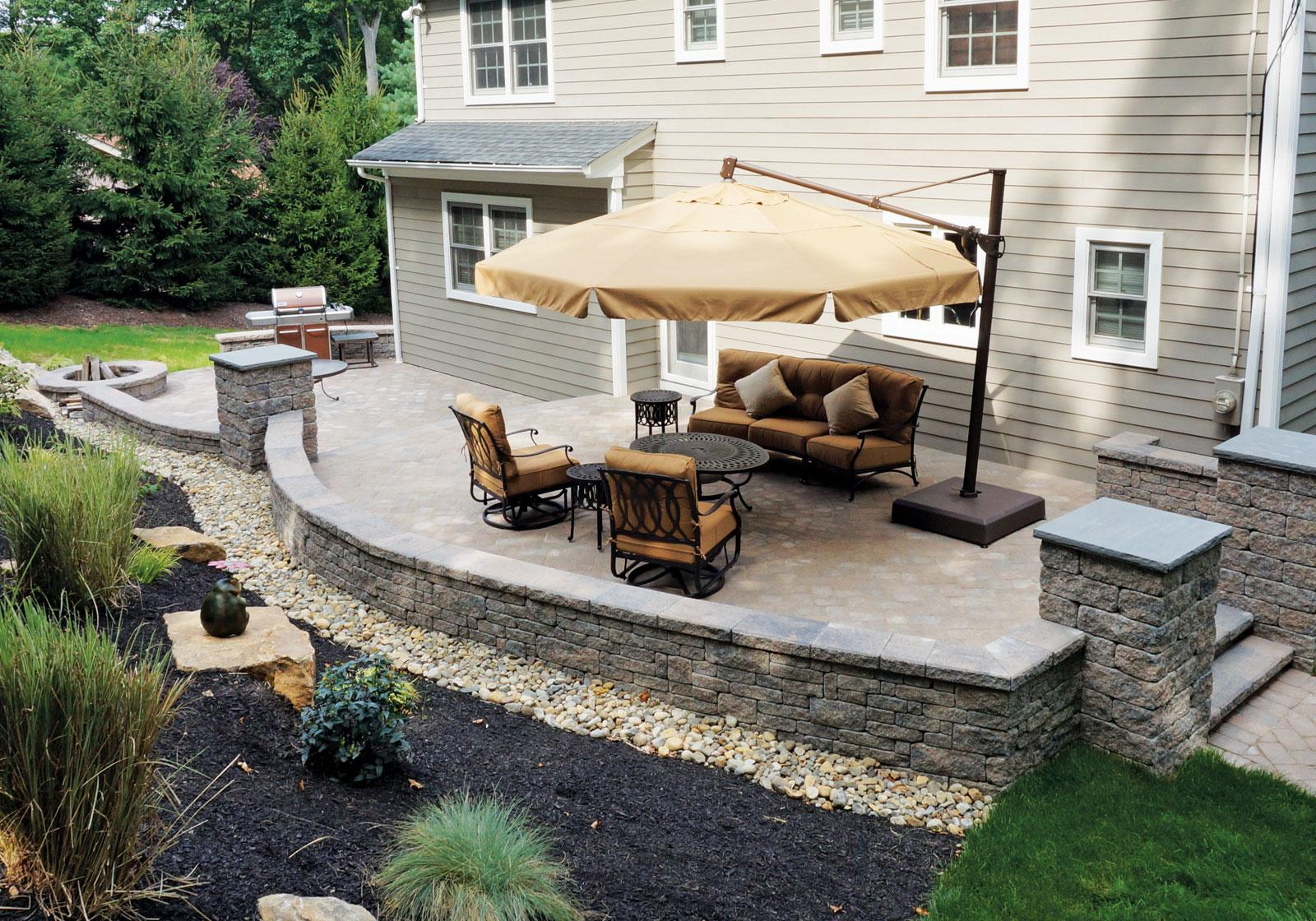 Backyard patios design ideas cornerstone wall solutions for Back patio design ideas