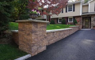 Pillar and wall next to driveway