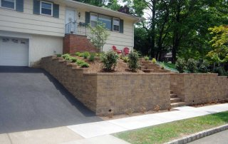 stairs and walls beside the driveway