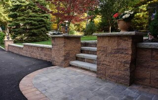 Retaining wall with pillars and stairs in Cincinnati Ohio