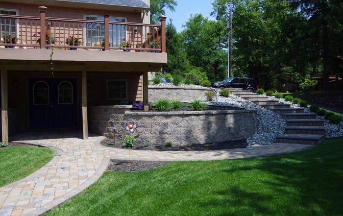 Backyard Curved Retaining Walls with Stairs