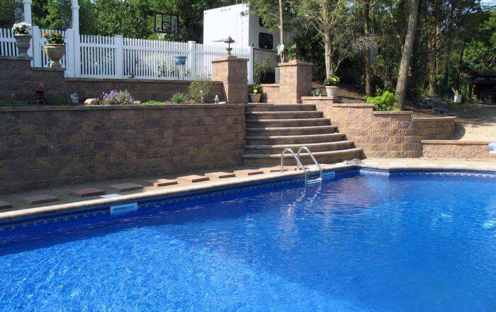 Backyard Retaining Wall with Long Pool