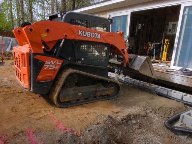 CornerStone retaining wall crush gravel backfill by Crafted Workshop