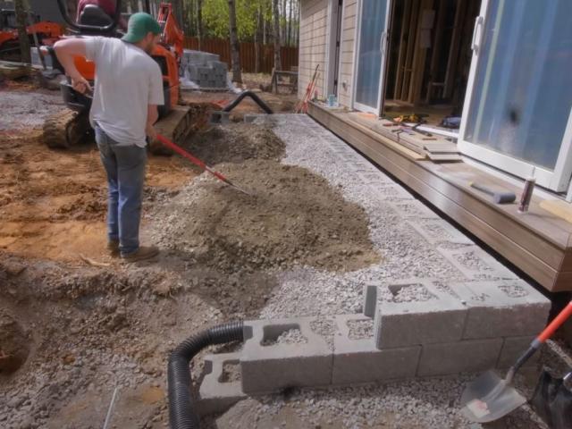 CornerStone retaining wall installation progress by Crafted Workshop
