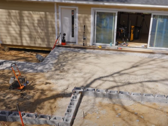 CornerStone retaining wall outline for raised patio by Crafted Workshop