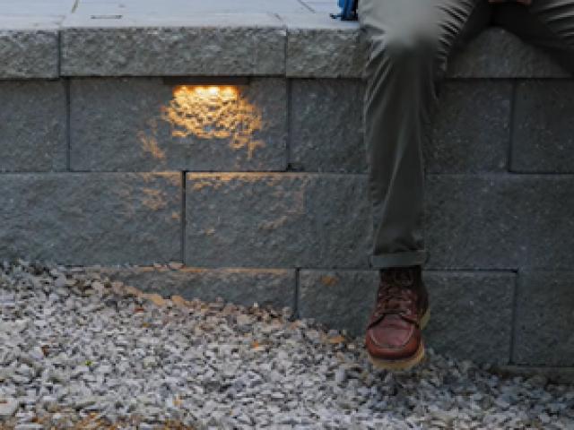 Finished CornerStone Raised Patio Retaining Wall with Under Cap Lighting
