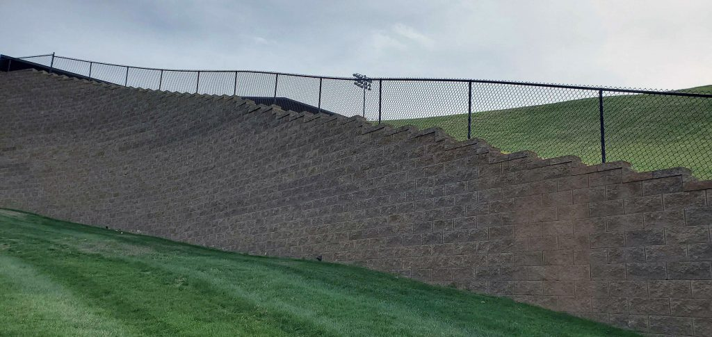 Tall, Fenced CornerStone Retaining Wall in Lynchburgh Virginia